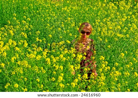 Young woman in the yellow flowers field - stock photo