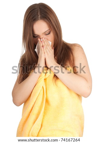 young woman in towel with snotty, runny nose and handkerchief