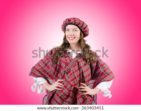 Young woman in traditional scottish clothing - stock photo