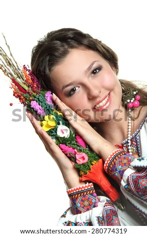 young woman in Ukrainian costume. national traditions, beautiful hair, bright emotions. with a bunch vines - stock photo