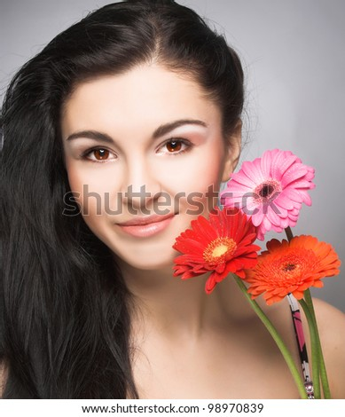 Young woman in violet dress and artistic visage with lollipop in her hands - stock photo
