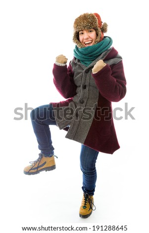 Young woman in warm clothing and gesturing - stock photo