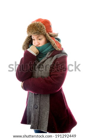 Young woman in warm clothing looking worried - stock photo