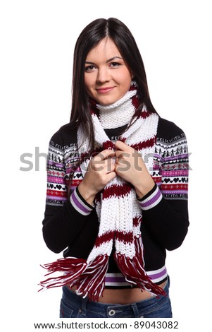 Young woman in warm sweater and scarf with happy smile - stock photo