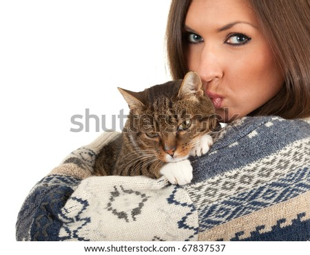 young woman in warm sweater kissing grey  cat - stock photo