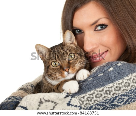 young woman in warm winter sweater with  cat - stock photo