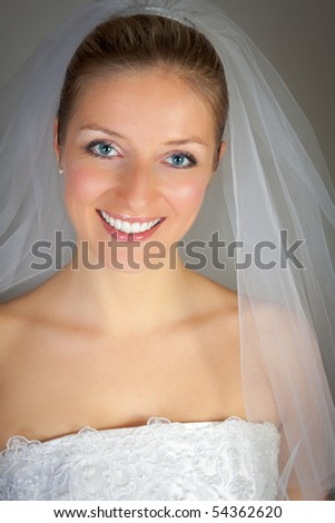 Young woman in wedding dress in studio - stock photo