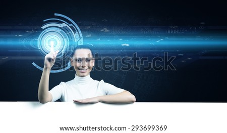 Young woman in white and virtual blue interfase - stock photo