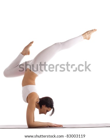 young woman in white balance on hands isolated - stock photo