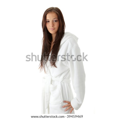 Young woman in white bathtub isolated