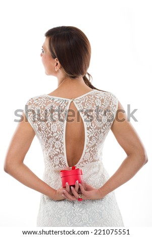 Young Woman in White Dress Sexy Back Holding Red Round Jewellery Case Isolated on White - stock photo