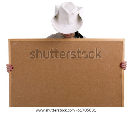 young woman in white hat keeping cork board
