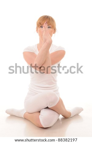 young woman in white in a yoga pose - stock photo