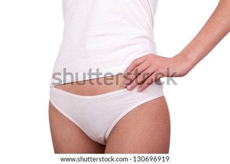 Young woman in white lingerie on the whitr background