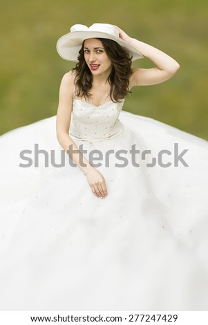 Young woman in white long dress and hat. Cutout. Copy Space. Mid Shot. MS - stock photo