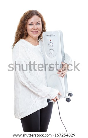 Young woman in white wool sweater holding new steel heater in hands. Isolated on white background - stock photo