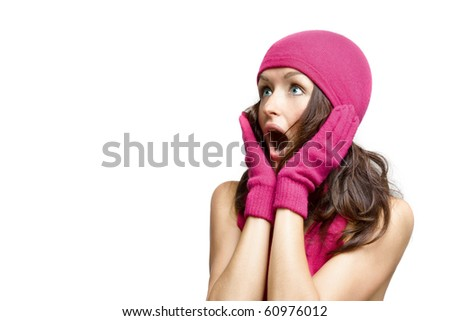 young woman in winter accessories looking very surprised - stock photo