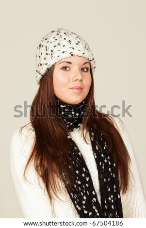 young woman in winter cloths  isolated on grey background