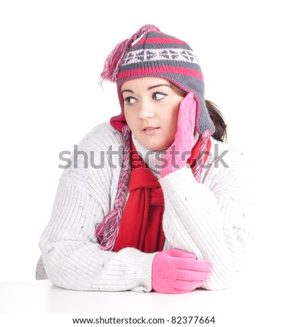 young woman in winter hat and mittens, series - stock photo