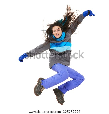 Young woman in winter sport clothing jumping isolated on white background
