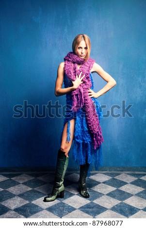 young woman in wool scarfs, studio shot, full body shot - stock photo