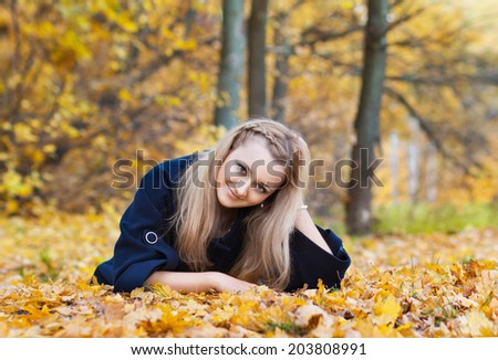 young woman in yellow autumn park