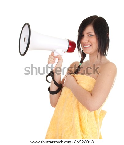 young woman in yellow towel with megaphone