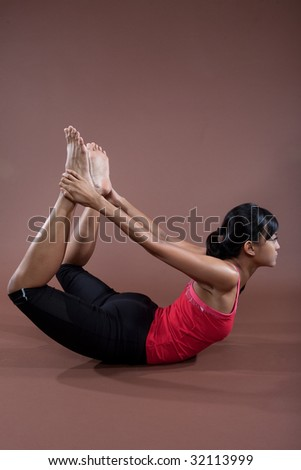 Young woman in yoga pose, as part of healthy lifestyle concept.