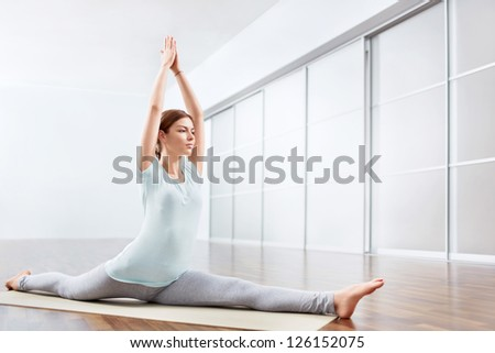 Young woman in yoga position - stock photo