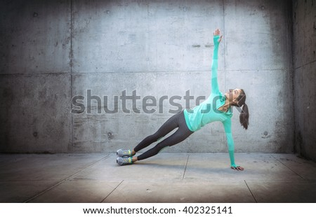 Young woman in yoga position gritty background