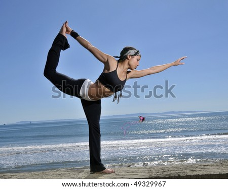 young woman in yoga stretch