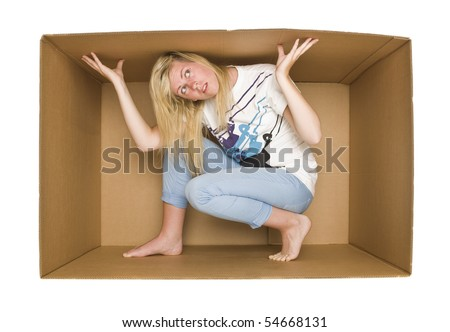 Young Woman inside a Cardboard Box isolated on white Background - stock photo