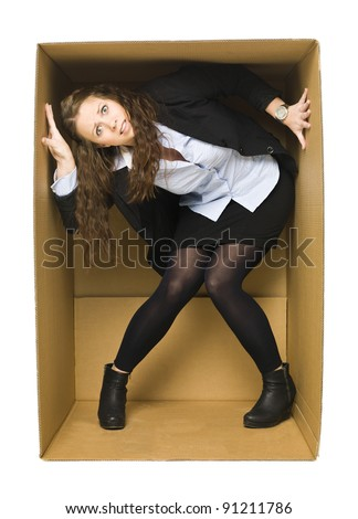 Young Woman inside of a tight Cardboard Box