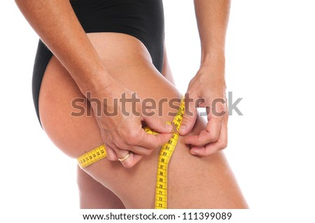 Young woman is checking her body - stock photo