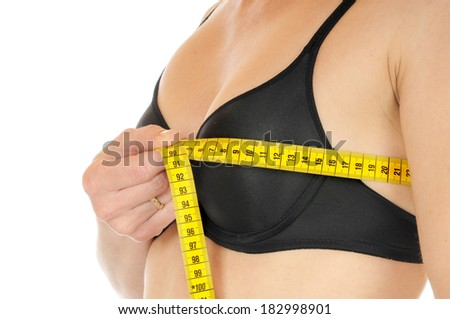 Young woman is checking her bust size - stock photo