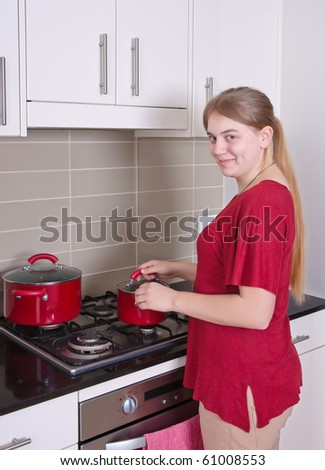 young woman is cooking in the kitchen