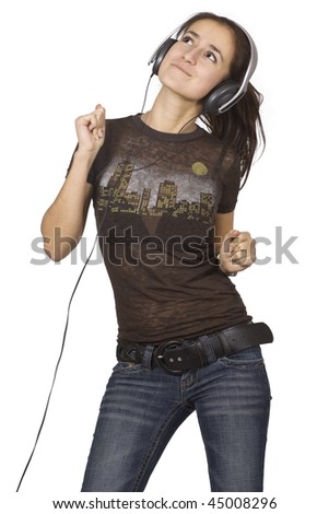 Young woman is dancing with large headphones on white background - stock photo