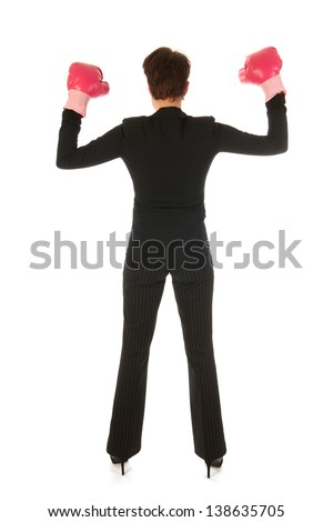 Young woman is enjoying a boxing fight in business isolated over white background