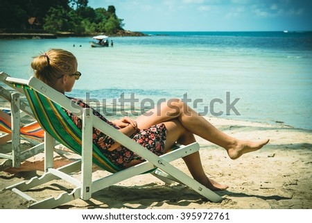 Young woman is enjoying at a sandy beach - stock photo