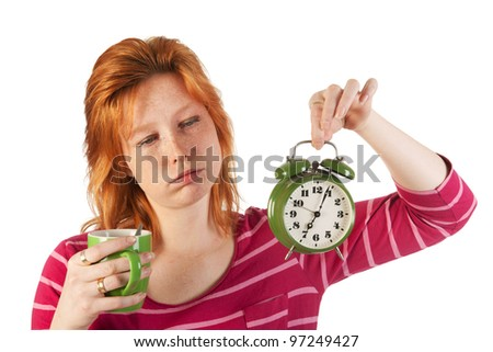 Young woman is enjoying her morning coffee while wake up very early - stock photo