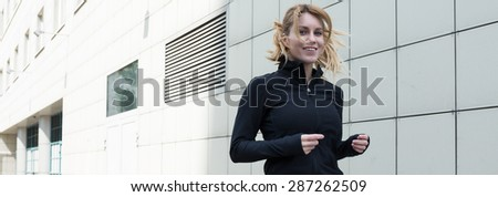 Young woman is happy when she runs - stock photo