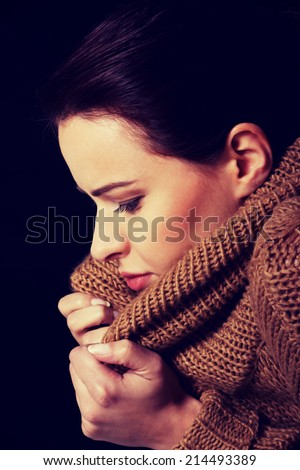 Young woman is having a depression. Over black background.