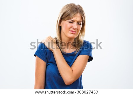 Young woman is having  pain in her shoulder.Pain in shoulder - stock photo