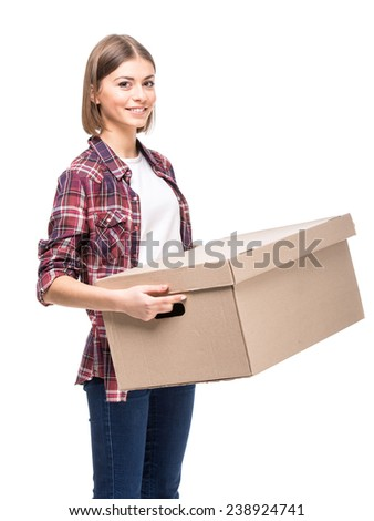 Young woman is holding a paper box, isolated on white background. - stock photo