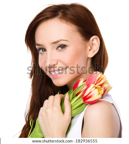 Young woman is holding bouquet of tulips, isolated over white