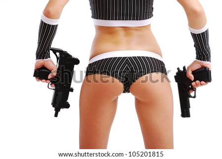 Young woman is holding handguns. She is standing back. Only her arms and  lower part of her sexy body are in sight. - stock photo