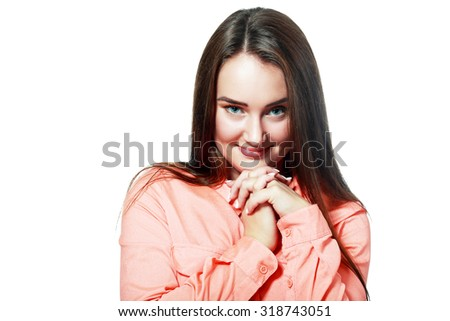 Young woman is holding her face in astonishment - stock photo