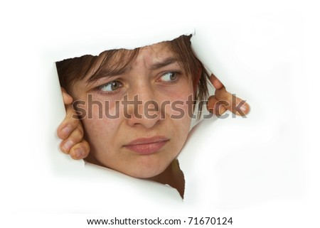 Young Woman is looking out of cutted paper.