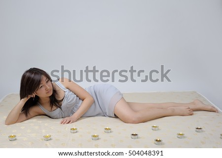 Young woman is lying on the mattress