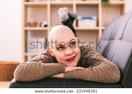 Young woman is overcoming cancer at home - stock photo